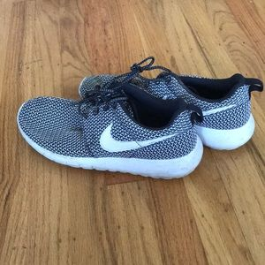 White and black patterned Nikes